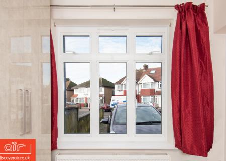 Red-curtains-next-to-air-flush-aluminium-windows